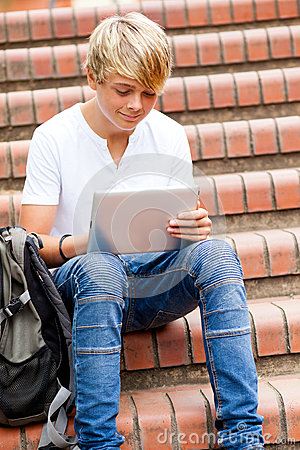 Teen using tablet computer