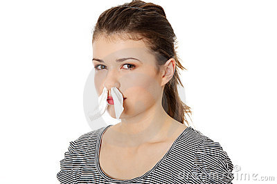 Teen woman with tissue in her nose