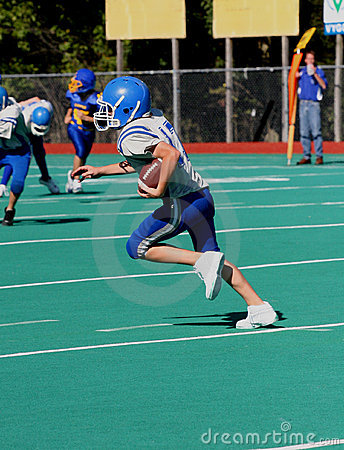 Teen Youth Football Player with Ball