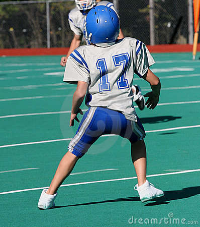 Teen Youth Football Player Ready to Catch