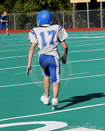 Teen Youth Football Player Running
