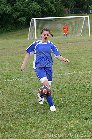 Teen Youth Soccer In Action on Field