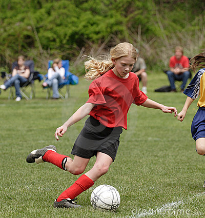 Teen Youth Soccer Player Kicking Ball