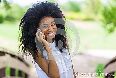 Teenage black girl using a mobile phone - African people