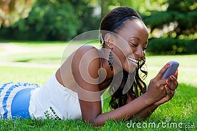 Teenage black girl using a phone