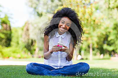 Teenage black girl using a phone - African people