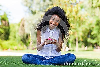 Teenage black girl using a phone - African people