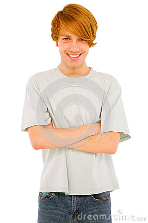 Teenage boy with arms folded