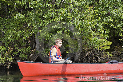 Teenage boy canoeing