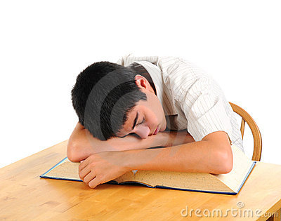 Teenage boy at desk asleep