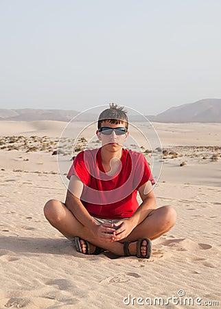 Teenage boy in dunes
