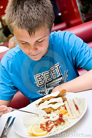 Teenage boy eating