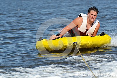Teenage Boy Getting Ready for His Next Tubing Tric