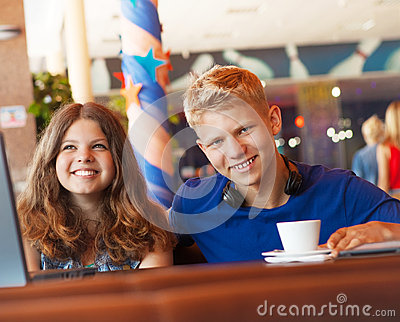 Teenage boy and girl in cafe