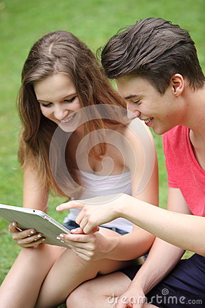 Teenage boy and girl using a tablet-pc