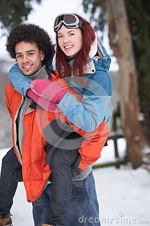 Teenage Boy Giving Girl Piggyback