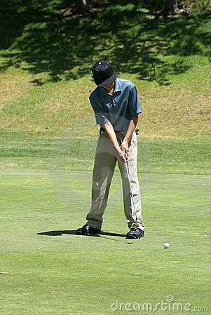 Teenage Boy Golfing