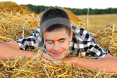 Teenage Boy in the Hay
