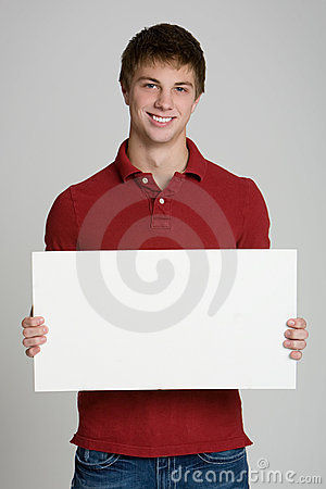 Teenage boy holding a blank sign isolated on white