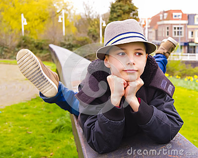 Teenage boy lying on the parapet at the park