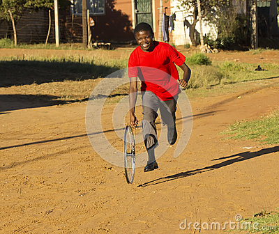 Teenage Boy Playing with Wheel