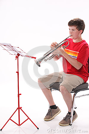 Teenage Boy Practicing Trumpet