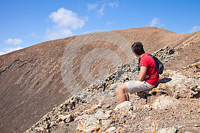 Teenage boy resting, hike up the caldera