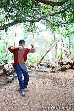 Teenage Boy on a Rope Swing