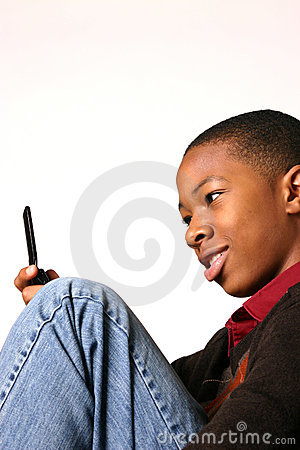 Teenage Boy Using Cell Phone