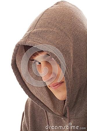 Teenage boy wearing hooded shirt
