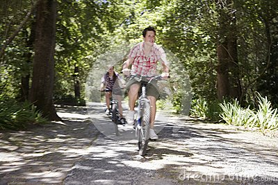 Teenage Boys Bicycling In Forest