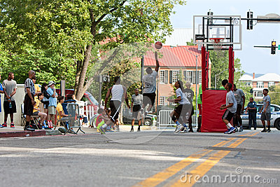 Teenage Boys Compete In Asphalt Basketball Tournament On City Street Editorial Stock Image