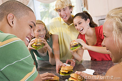 Teenage Boys Eating Burgers
