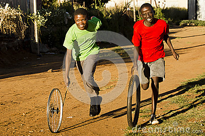 Teenage Boys Playing with Wheel