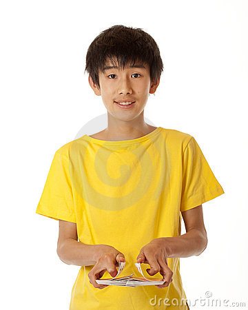 Free Teenage Chinese Asian Boy Shuffling Cards Royalty Free Stock Photography - 19433797