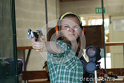Teenage competitor at shooting range