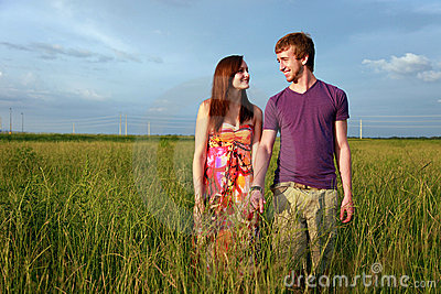 Teenage couple in field