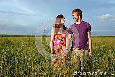 Teenage couple in field
