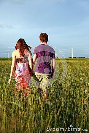 Free Teenage Couple Holding Hands Royalty Free Stock Image - 10849156