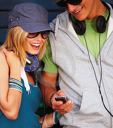 Teenage couple looking at cellphone