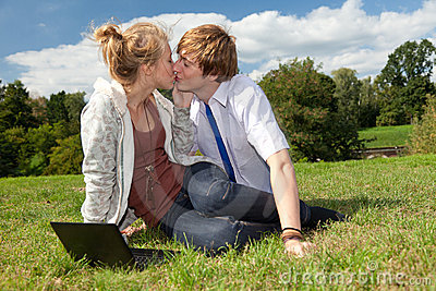Teenage couple using laptop