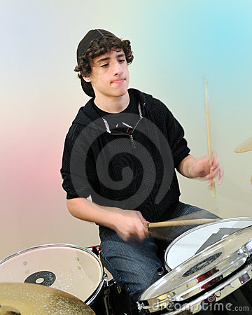 Teenage drummer in action
