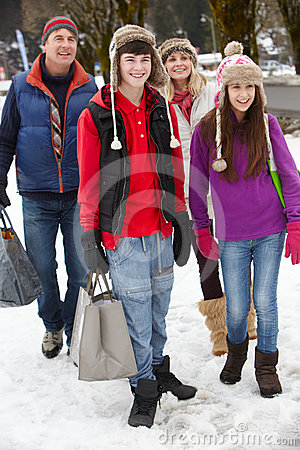 Teenage Family Carrying Shopping