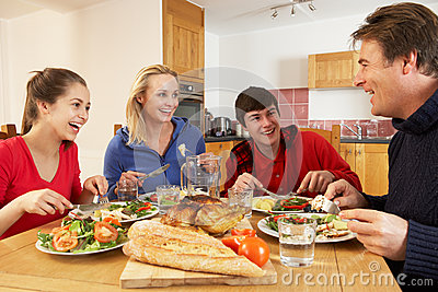 Kitchen Designs on Teenage Family Eating Lunch Together In Kitchen Stock Photos   Image