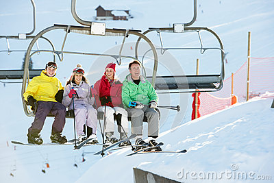 Teenage Family Getting Off Chair Lift On Holiday