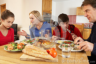 Teenage Family Having Argument Whilst Eating Lunch