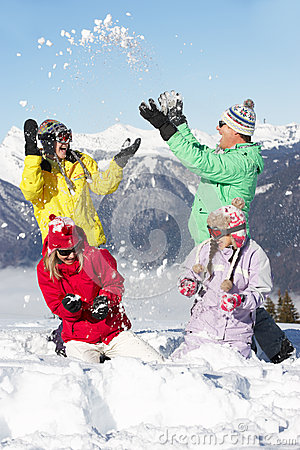 Teenage Family Having Snow Fight In Mountains