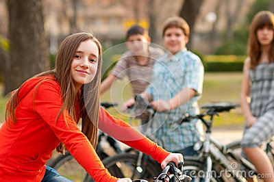 Teenage friends on bicycles