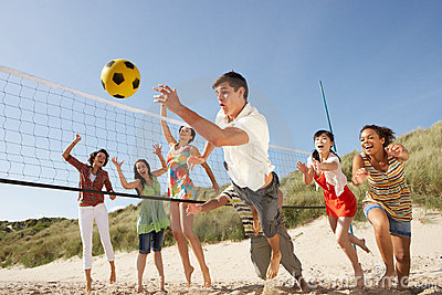 Teenage Friends Playing Volleyball On Beach Royalty Free ...