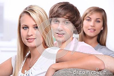 Teenage friends sitting on sofa